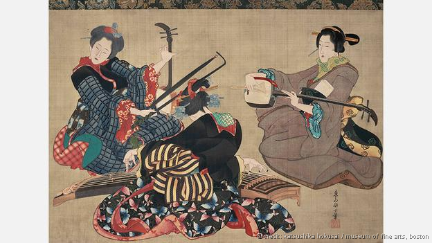 Hokusai's Three Women Playing Instruments is a hanging scroll, executed with ink on silk (Credit: Katsushika Hokusai / Museum of Fine Arts, Boston)