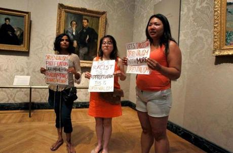 John Blanding/Globe Staff  Protesters in the museum decried the program.